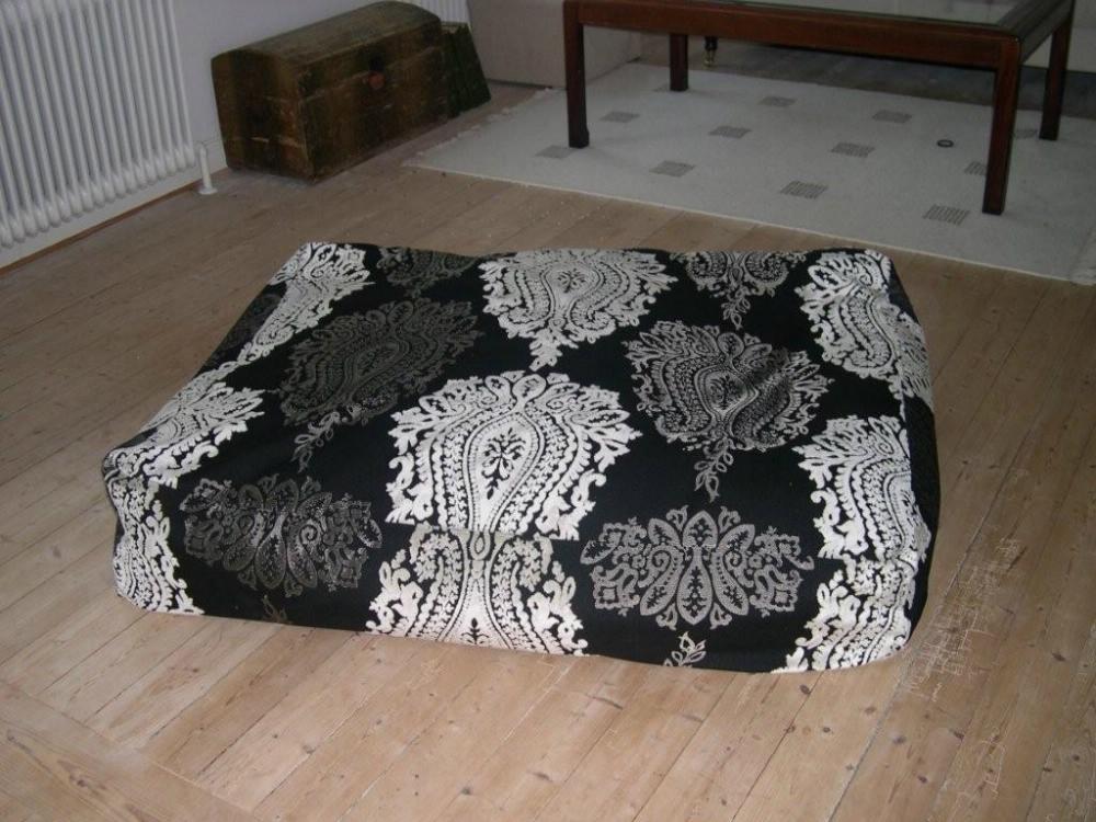 Ombetrukken gulvpude